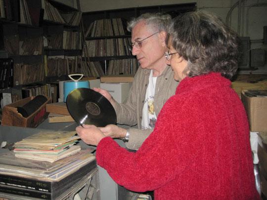 Nathan Tinanoff and Marlene Englander (Jack saul's daughter) examine records
