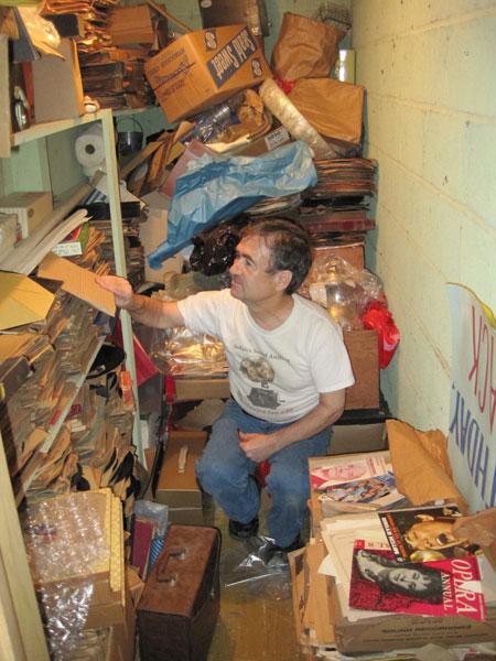 Ben Roth-Aroni looking for treasures in a hidden closet