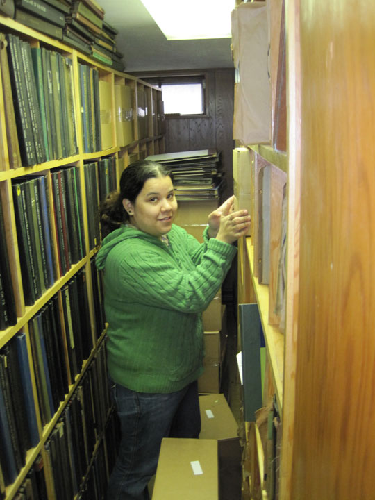 Alethea Perez packing recordings previously identified in the Saul's house.