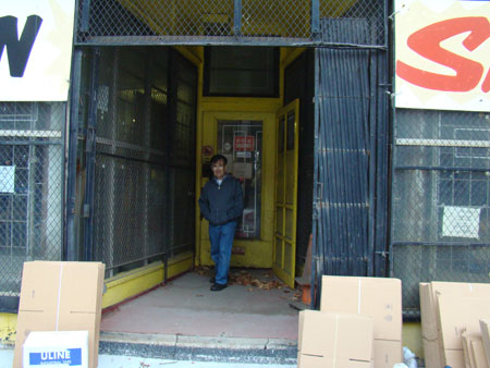 Ben Roth in front of store with folded boxes
