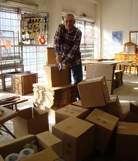 Nathan Tinanoff making boxes in furniture store.