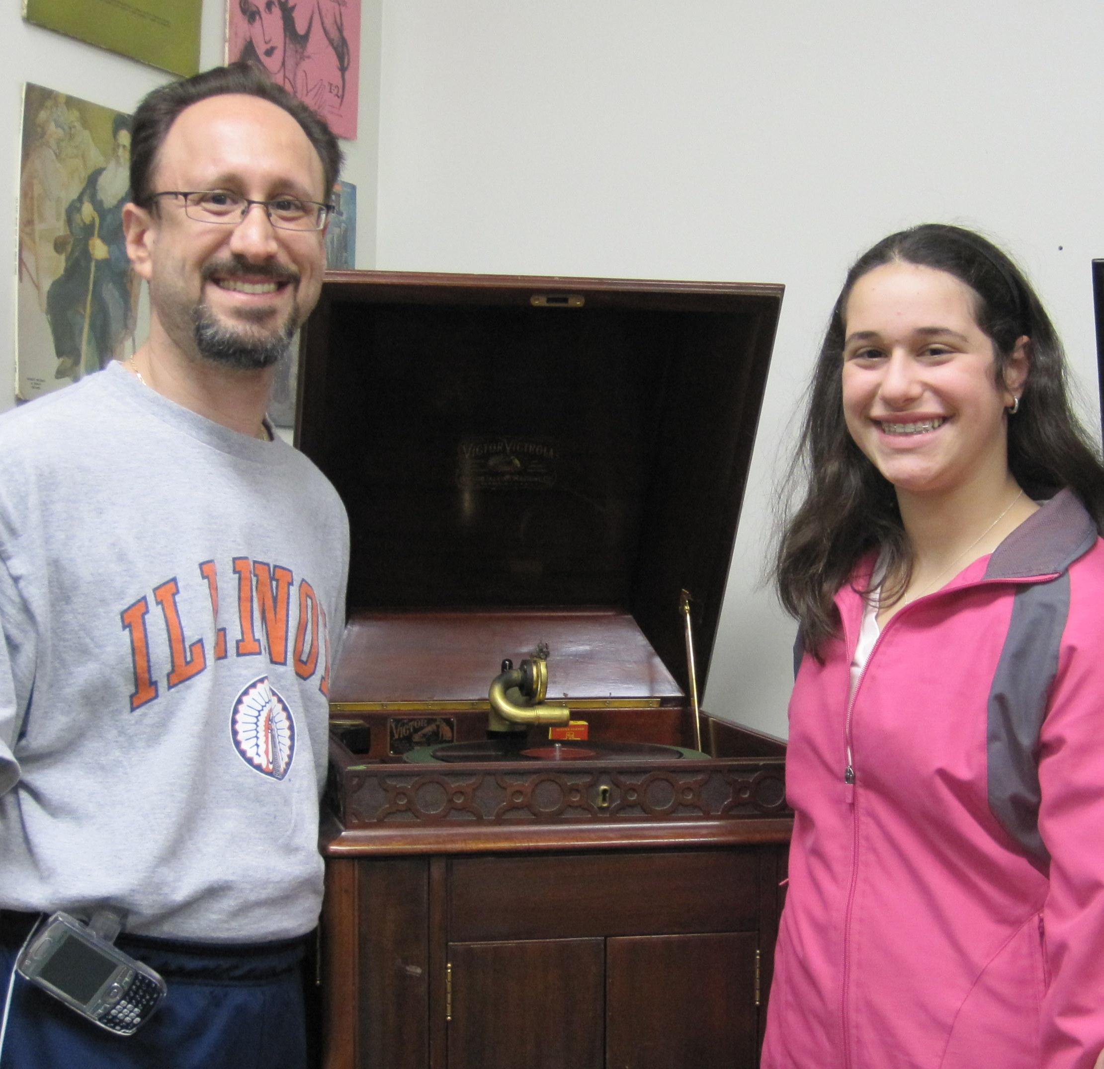 Ari and Ben Goldstein admire vintage Victrola at JSA
